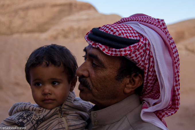 Bedouin child with his father