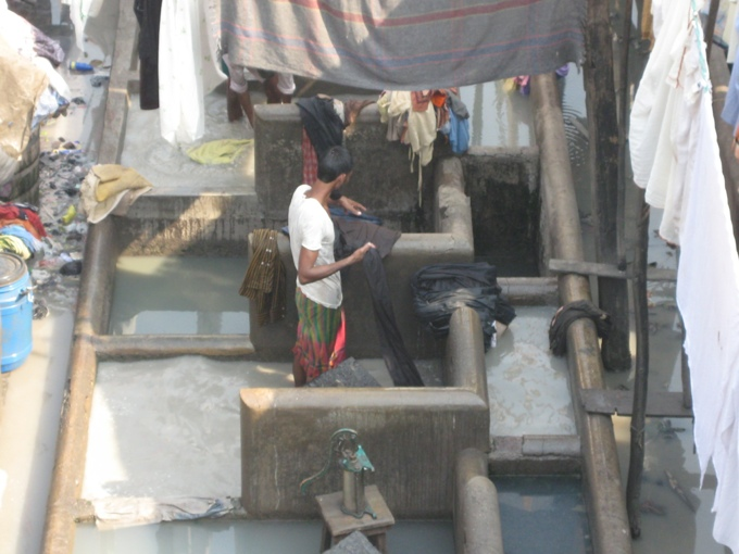 Dhobi wallah washing clothes at the Dhobi Ghat, Mumbai